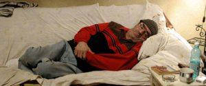 Man lying on settee