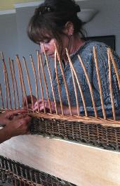 Weaving a willow coffin
